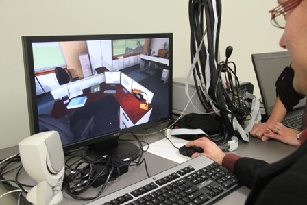 Client participating in a study that examins the application of virtual reality to TBI