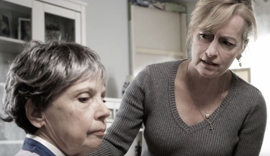 Image of two women, one with a concerned look on her face