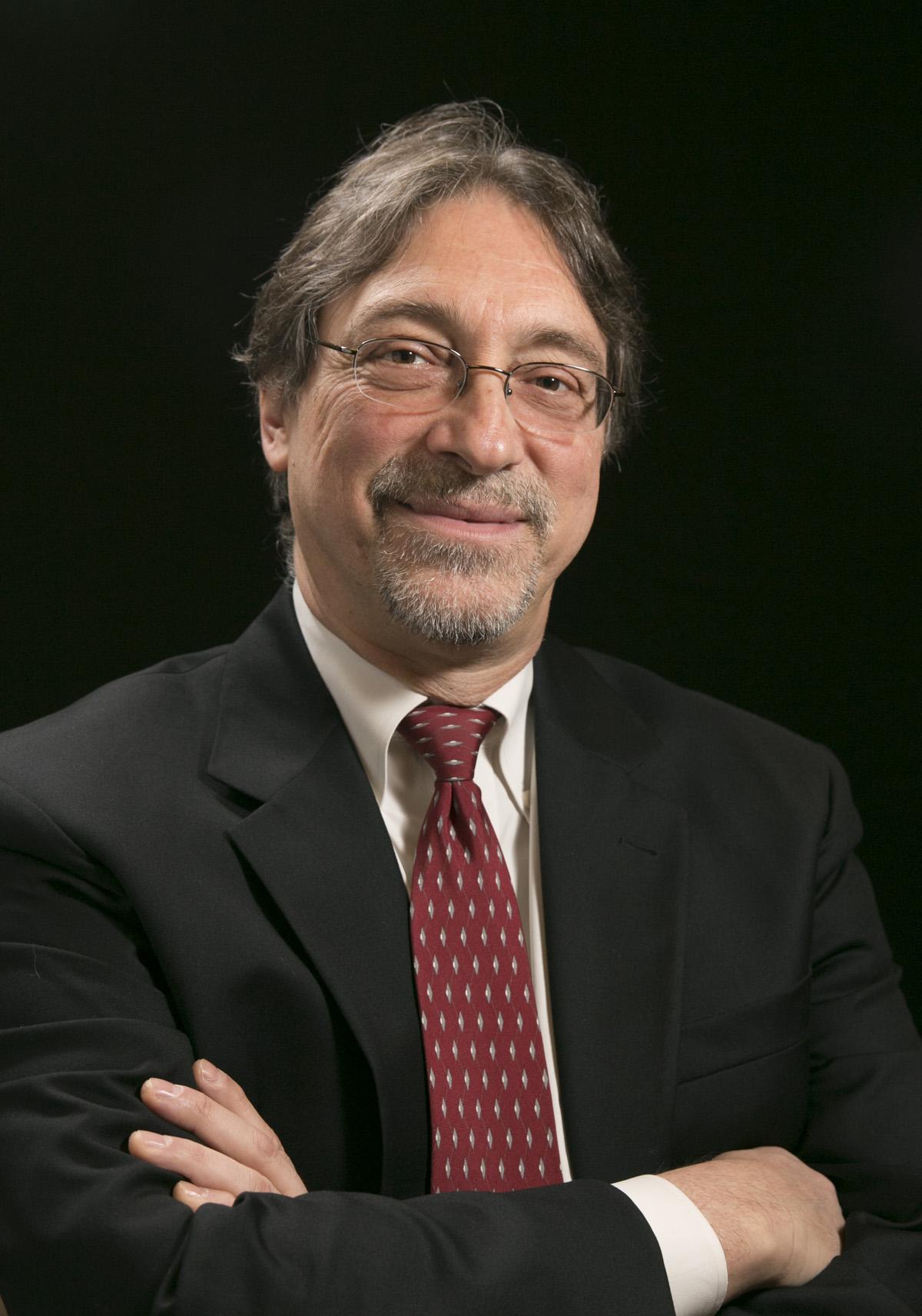 Head-shot of Dr. John DeLuca