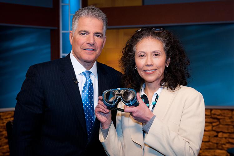 TV host Steve Adubato with Dr. AM Barrett holding prism goggles