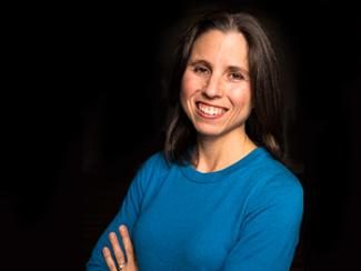 Headshot of Denise Krch, PhD with a Black Background