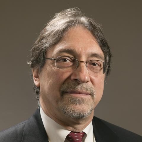 Head shot of Dr. John DeLuca