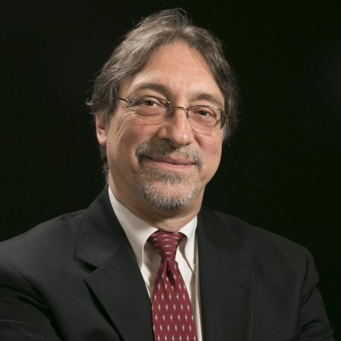 Head-shot of Dr. John DeLuca