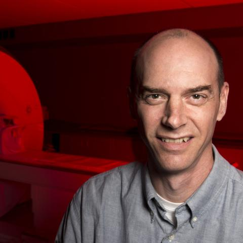 Glenn Wylie in Imaging Room with Red Light