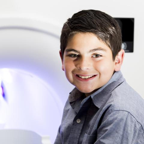 Mock Scanner with boy sitting in front of it