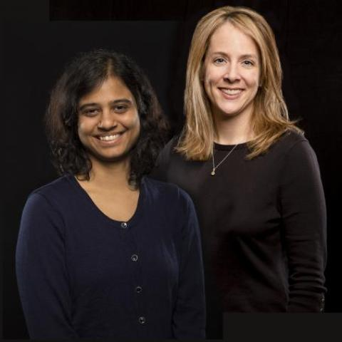 dr nolan wearing a dark blue shirt standing with dr. Karunakaran wearing a black shirt