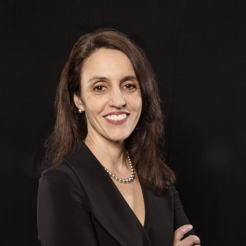 Dr. Amanda Botticello standing against a black background