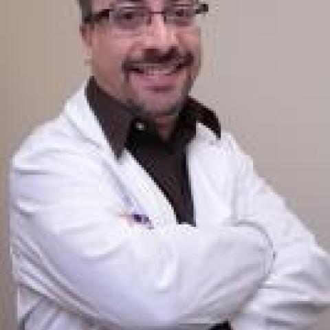 Anthony Lequerica, PhD with his arms crossed wearing a lab coat