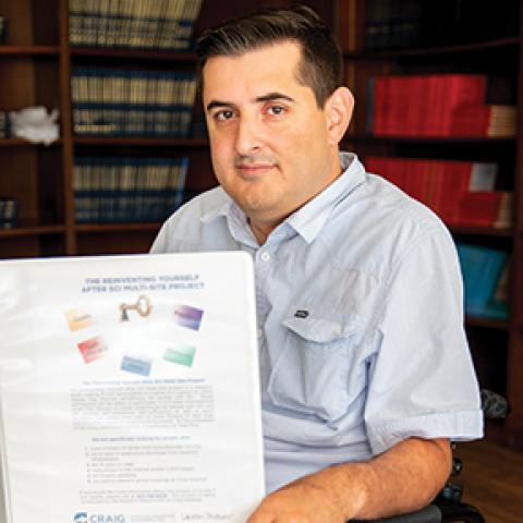 Photo of Gianfranco Gervasio against background with books