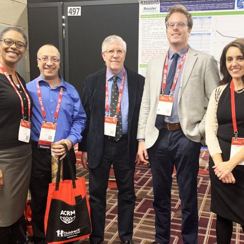 Photo of five Kessler researchers at ACRM conference