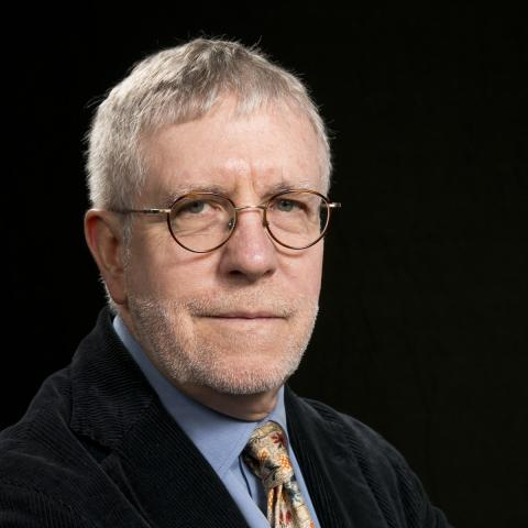 Head shot of Dr. John O'Neill, against a black background