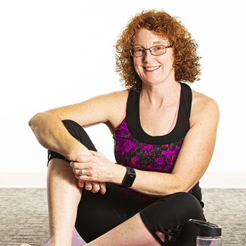 Rosemarie, woman with MS, on a yoga mat