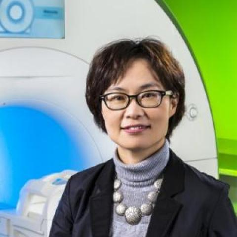 Dr Oh Park standing in front of the MRI Scanner