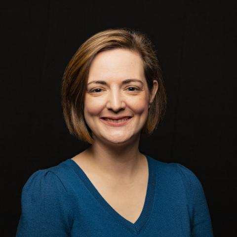Head-shot of Dr. Helen Genova against a black background