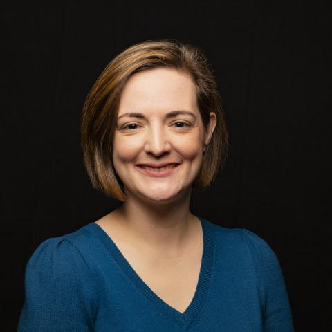 Head shot of Dr. Helen Genova against a black background