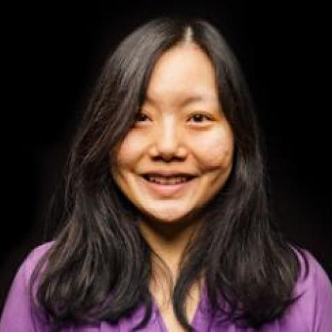 Head-shot of Dr. Xuan Liu against a black background