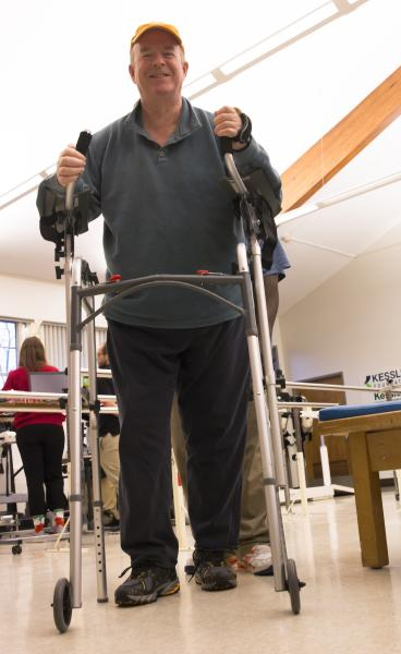 participant who is wheelchair bound doing physical therapy intervention to walk again
