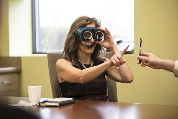 First lady of NJ tries on prism adaptation glasses, which are used for spatial neglect after stroke