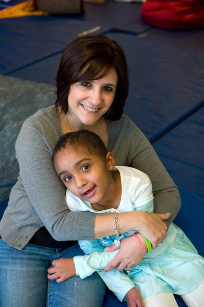 Pediatric traumatic brain injury TBI child with mother at physical therapy PT