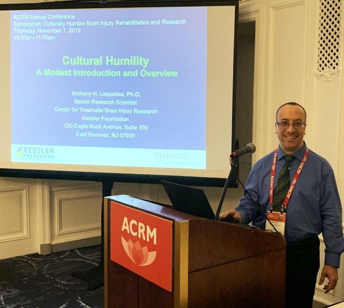 Photo of Dr. Anthony Lequerica presenting at the ACRM conference
