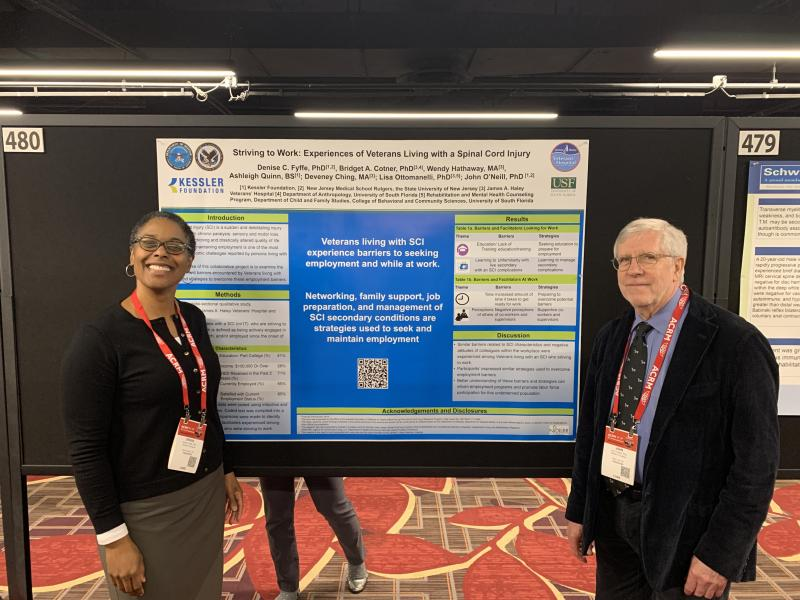 Photo of Drs. Denise Fyffe and John O'Neill presenting their poster