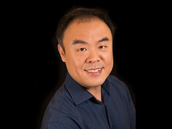 Headshot of Brian Yao, PhD with a Black Background